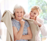 caregiver comforting senior woman